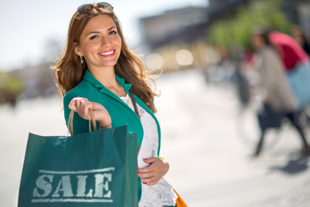 Happy beauty shopping woman holding bags Stock Photo