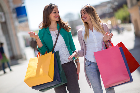 Two beautiful women in buying on the shopping day