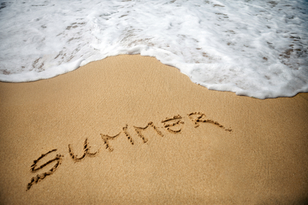 summer written in a sandy tropical beach Stock Photo