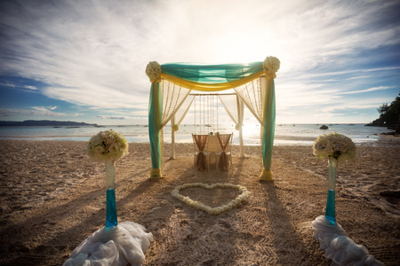 beach wedding ceremony on white sandy beach