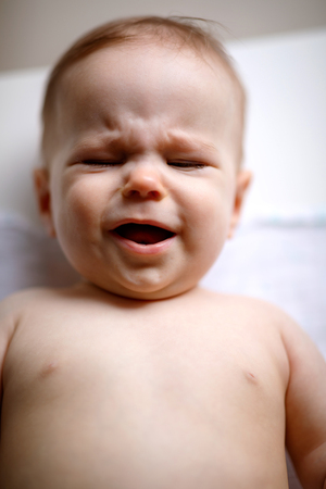 Crying cute little male baby
