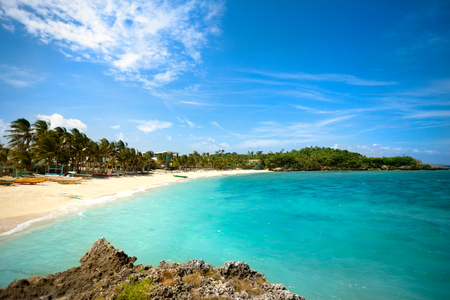 Tropical beach lagoon with palm trees at Bali Stock Photo