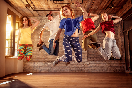 Dancer team - young dancer people jumping during music Stock Photo