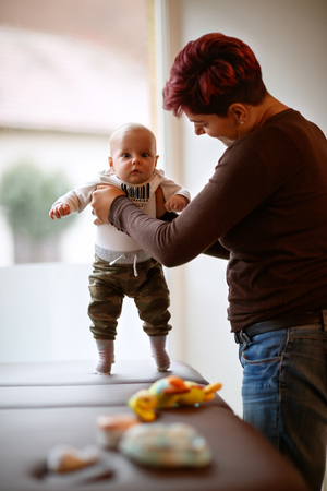 Cute little boy with his mom indoor