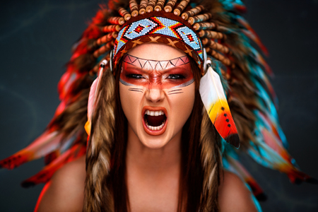 Wild Indian woman warrior with colorful headdress Stock fotó