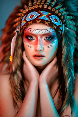 Portrait of Indian American female with ceremonial feather hat