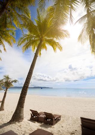 sunbeds on sand beach resort Stock Photo