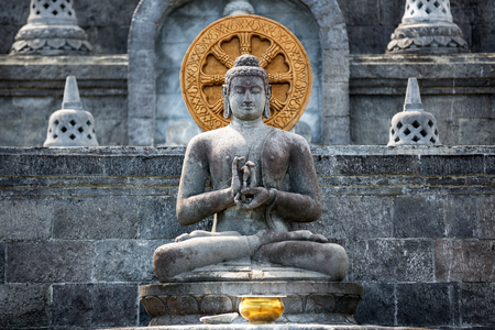 Statue of Buddha on stone platform