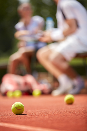 Close up of tennis ball on tennis court