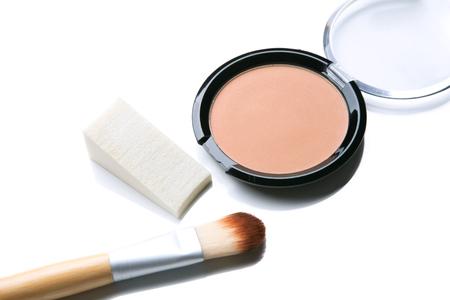 powder makeup with sponge isolate on white Stock Photo