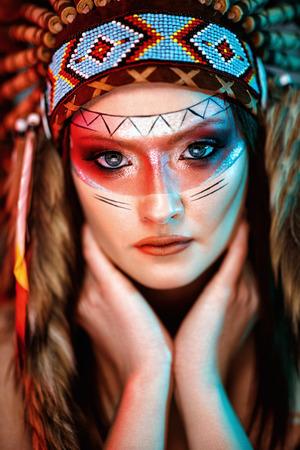 warrior woman portait with feather headdress