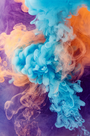 Acrylic colors and ink in water background Stock Photo