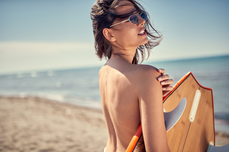 Surfer girl. Sexy young woman at the beach. water sports. Stock Photo