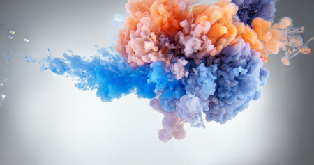 Acrylic colors and ink splash in water background Stock Photo