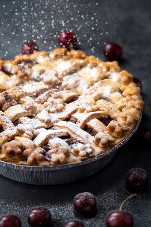 traditional cherry pie with sprinkles powdered sugar 写真素材