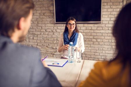 Nervous girl on job interview Фото со стока