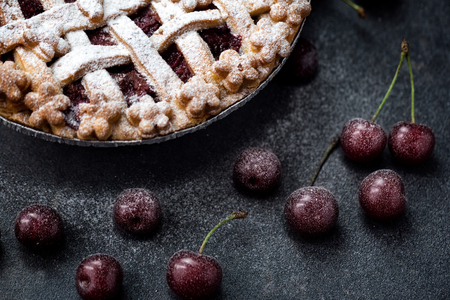 Delicious pie with fresh cherries, icing sugar