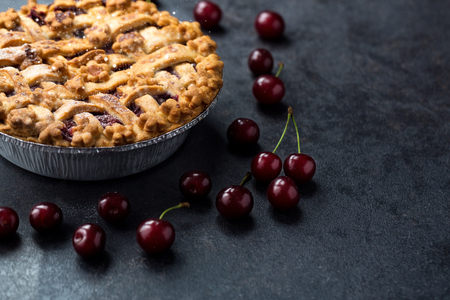 homemade cherry pie on dark background 写真素材