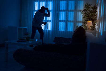 Burglary breaking into a home Zdjęcie Seryjne