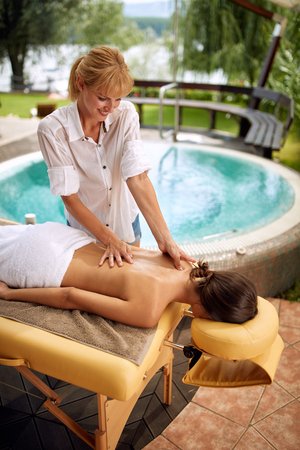 Spa Woman. Female Enjoying Massage at home on outdoor Stock Photo