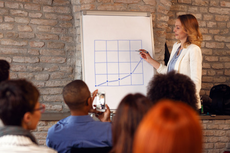 Business woman having presentation on seminar about success in business
