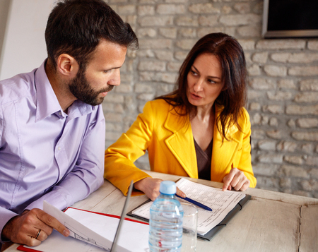 Woman and man in studio consults about working task Stock Photo