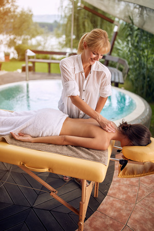 Back Massage-Woman at the spa getting a relaxed massage