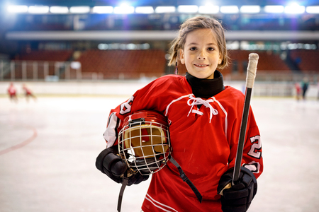 Youth girl hockey players in ice Stok Fotoğraf