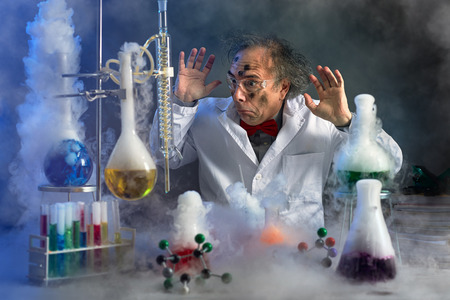 frightened scientist looking at explosion in laboratory