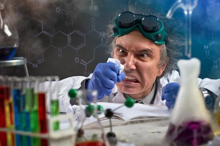 Angry chemist  wreak their displeasure on crumpled paper Imagens