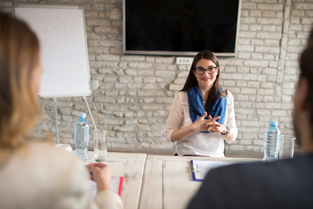 Nervous woman talking with commission on interview for job