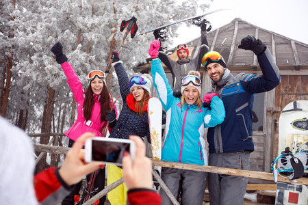 Group of cheerful skiers on winter holiday, group photo 写真素材