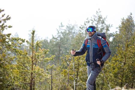 Smiling male hiker hiking in forest Banco de Imagens