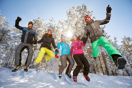 Group of young skiers in jump on snow