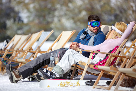 Woman and man in love resting in sun lounger Stock Photo