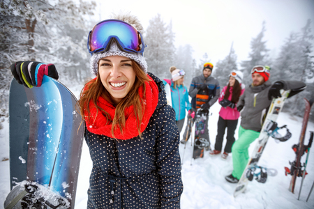 Female snowboarder on ski terrain at winter Stock Photo