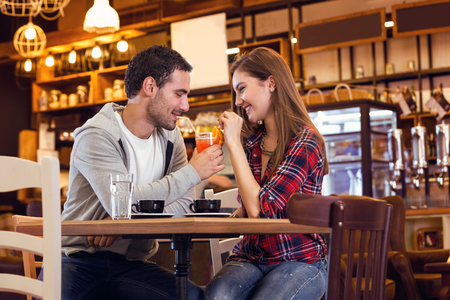 Romantic couple in cafe drinking cocktails 版權商用圖片
