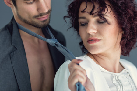 Close up od sexy seduction between attractive woman and man 版權商用圖片