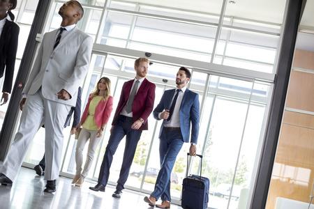 Handsome businessmen walking in airport building Stock Photo - 112073293