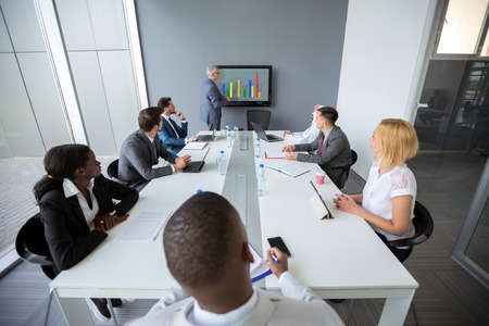 Employees listen director's business plan in companys meeting room Imagens
