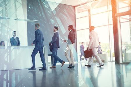 Business people arriving at reception desk