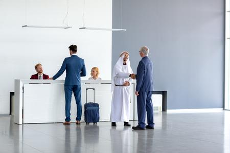 Director warmly receive Arabian guest on entrance