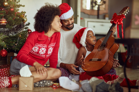 family with the song together celebrate Christmas holiday