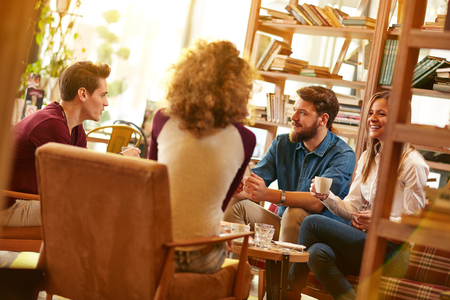 Group of students talking and drink coffee in cafeteria Stock Photo