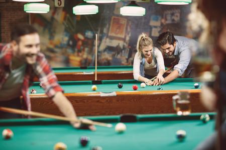 Funny time in billiard club with happy friends Archivio Fotografico - 117676243