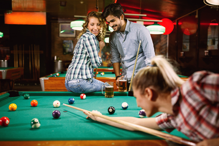 fun with best friends playing billiard game