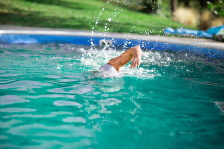 Man practicing swimming, health and fitness lifestyle concept Stock Photo