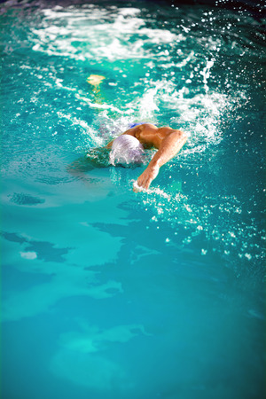 Health and fitness lifestyle concept with young athlete swimmer recreating on outdoor