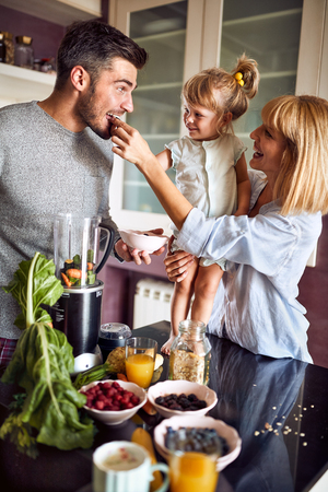 Family with child taking healthy meal at morning Standard-Bild - 121569437