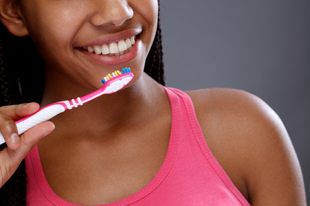 Young girl with toothbrush and wonderful white teeth